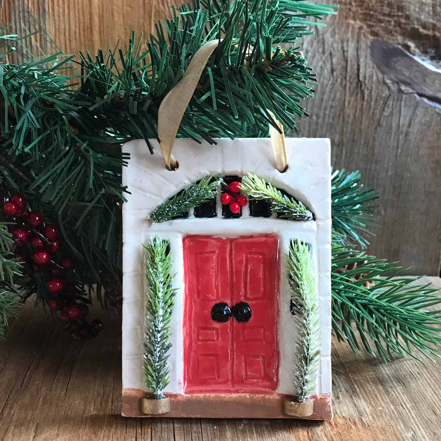"""Doornament with Red Door and Greenery"" ‑ Handbuilt Pottery Piece, 3"" x 5"""