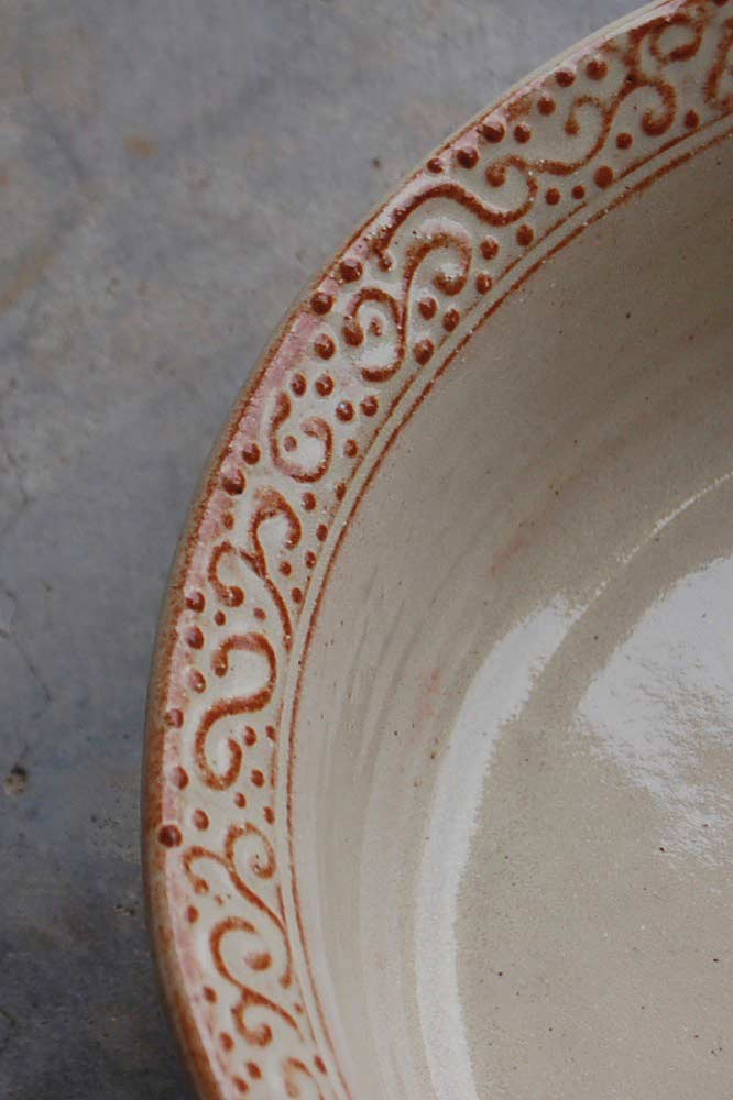 Detail of Slip‑trailed Rim of Serving Dish, Hand thrown and altered stoneware, food safe cream glaze